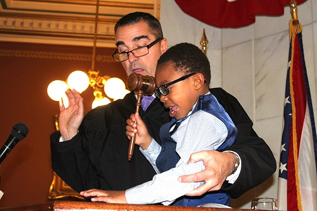 Mahoning County Probate Court Judge Robert Rusu, left, helps Nathan Cain, 5, drop the gavel formally finalizing his adoption to the Cain family of Troy during a ceremony Friday, Nov. 1, 2019 at the Mahoning County Courthouse.