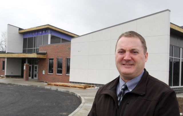 Campbell City Schools Superintendent Matthew Bowen stands outside the new Community Literacy Workforce and Cultural Center in Campbell. The facility will open May 1. (Photo by William D. Lewis)