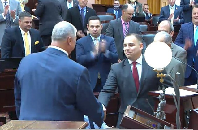 Newly appointed Ohio 59th District State Rep. Alessandro Cutrona, right, shakes hands with Ohio House Speaker Larry Householder, left, after being sworn in on the Ohio House floor on Thursday, May 28, 2020. (Ohio Channel)