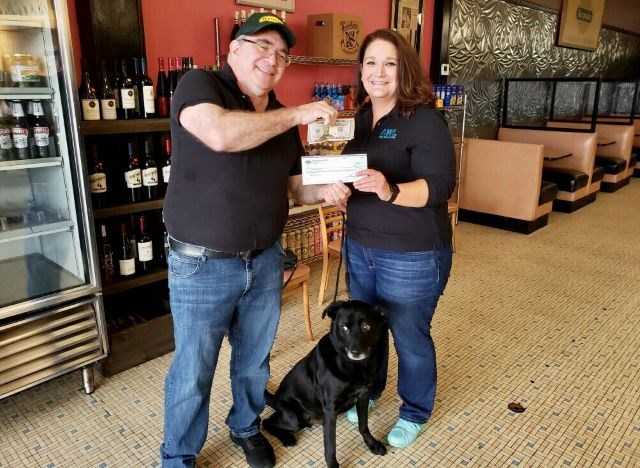Jack Kravitz, president of Kravitz Deli, presents a $500 check to Lori Shandor, CEO of the Animal Welfare League of Trumbull County. (Contributed photo)
