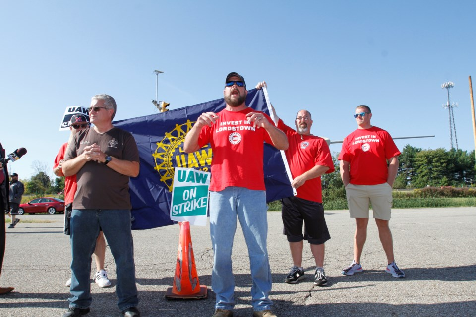 Striking UAW workers  at the closed GM Lordstown plant in this September file photo. By Robert K. Yosay