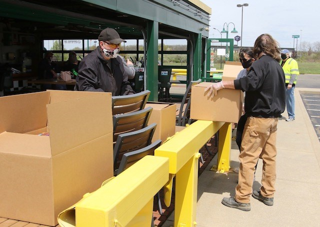 Dick Frost and his car enthusiast group the Chicken Coupe Cruisers sorted more than 250 boxes of mostly non-perishable goods to be handed off to residents Sunday at the Quaker Steak & Lube in Austintown. (Robert K. Yosay | Mahoning Matters)