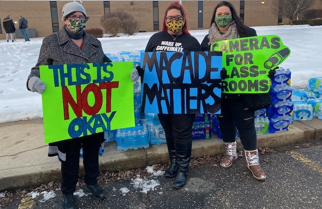 From left, Cindy Bussard of Columbiana, Brittany Keller of Massilon and Brenda Staffrey of Austintown show their support for Macade at a rally outside Boardman High School. (Jess Hardin | Mahoning Matters)