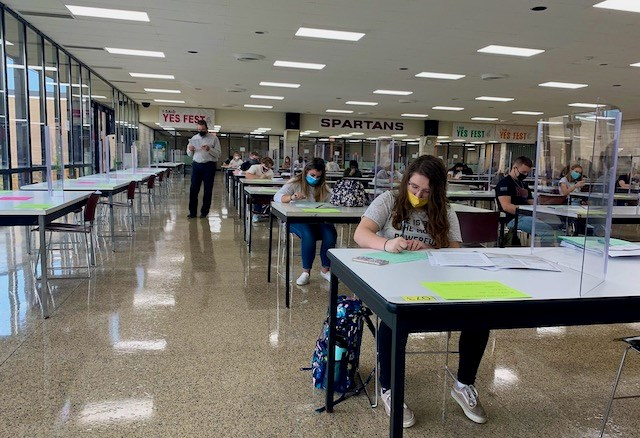 Some High School students at Boardman High School meet for homeroom in the morning in the cafeteria, which has new plexiglass dividers at every table. (Photo provided)