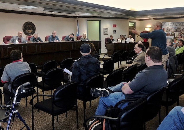 Boardman Township Trustees listen as resident Mike Sprague expresses his frustration during the Dec. 30 meeting to voted to designate the Southern Park Mall a Community Entertainment District. (Photo by Jess Hardin)