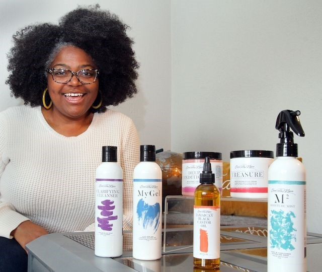 """""""A lot of [textured and curly hair] companies don't come from the Midwest. So we were able to really meet a demand here in the Mahoning Valley,"""" said Carmella Williams, owner of Carmella Marie Hair and Beauty. (Photo by William D. Lewis)"""