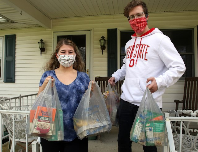 GroceryGrab is a new delivery service made up of volunteers. Doing their part in the COVID-19 battle are Sara Kauffman and Matthew Ellis. They shop and deliver groceries for the cost of gas. (Photo by Robert K. Yosay)