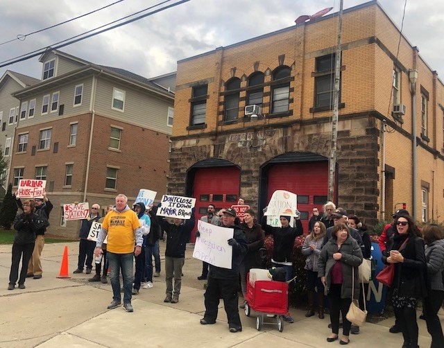 About three dozen concerned citizens gathered at Fire Station No 7 on the city's North Side to protest the city's decision to close the station as a cost cutting measure. (Photo by Jess Hardin)