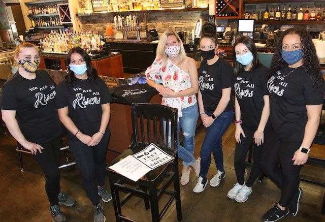 The Riser Tavern and Grill staff — Brittany Freshcorn, Angela Gennaro, owner Lisa Lorelli, Courtney Frommelt, Haley O'Connor and Nichole Tarr — were masked and ready to go Thursday. (Bob Yosay/Mahoning Matters)