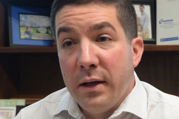 Anthony Cafaro Jr. describes the Cafaro Co.'s mall investment strategy in his office at the Eastwood Mall Complex on Jan. 16. (Photo by William D. Lewis)