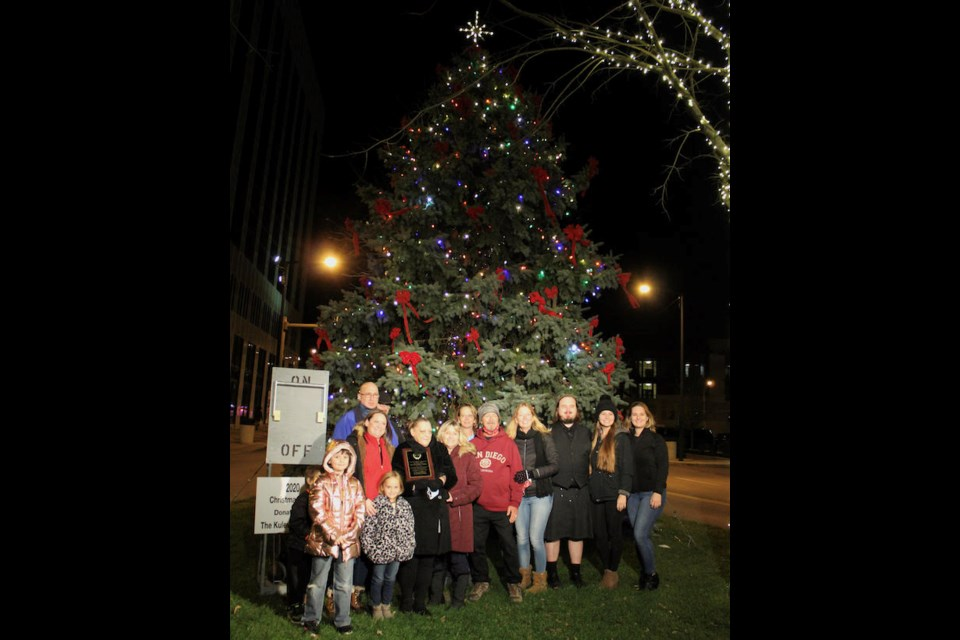 The family of longtime Boardman residents Patrick and Marilyn Kulewsky gathered to light the Youngstown Christmas tree on Friday. (Photo by Ellen Wagner)