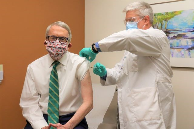 Gov. Mike DeWine receives his second dose of the COVID-19 vaccine today from Dr. Kevin Sharrett at Kettering Health Network in Jamestown, Ohio. (Photo courtesy of Gov. Mike Dewine's Office)