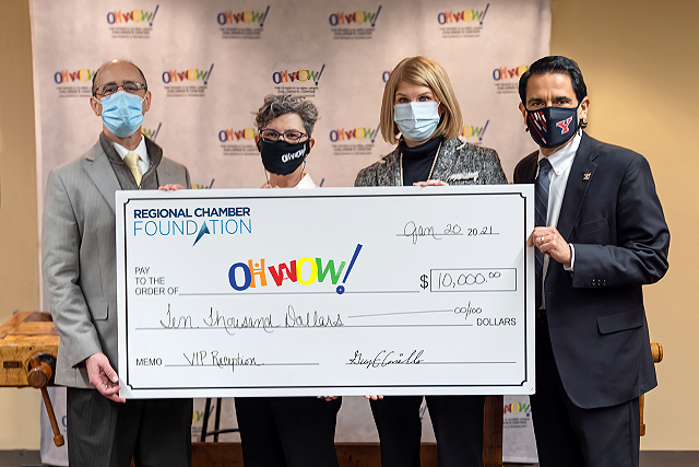 Guy Coviello, left, Regional Chamber Foundation president, presents a $10,000 check to OH WOW! President and Executive Director Suzanne Barbati, second from left, and board members Merry Wagner and Charles George. (Contributed photo)