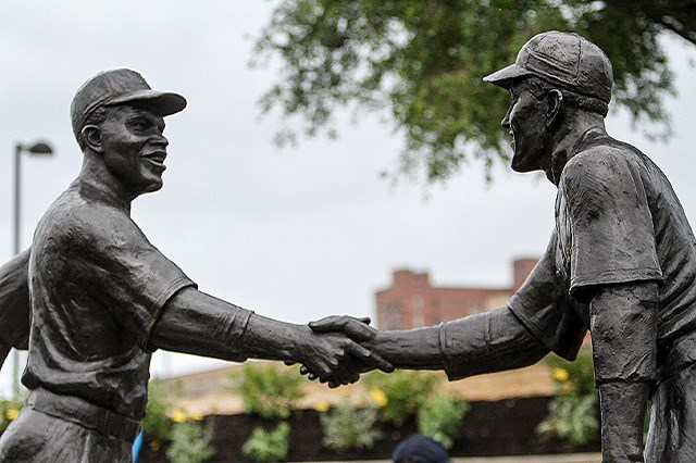 The Robinson-Shuba Commemorative Statue was unveiled Saturday in Wean Park in Youngstown. The statue commemorates the handshake between Jackie Robinson and Youngstown native George Shuba after Robinson, a veteran of the Negro Leagues, hit his first home run in 1946 when they were teammates with the Montreal Royals of the International League. (Robert K. Yosay | Mahoning Matters)