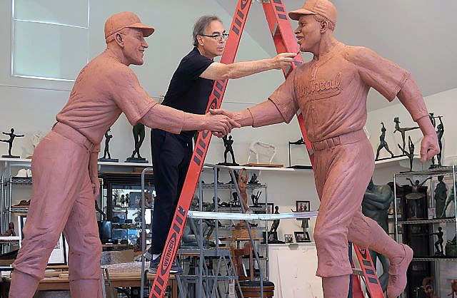 Sculptor Marc Mellon applies finishing touches to the final model of the Robinson-Shuba Commemorative Statue. (Contributed photo)