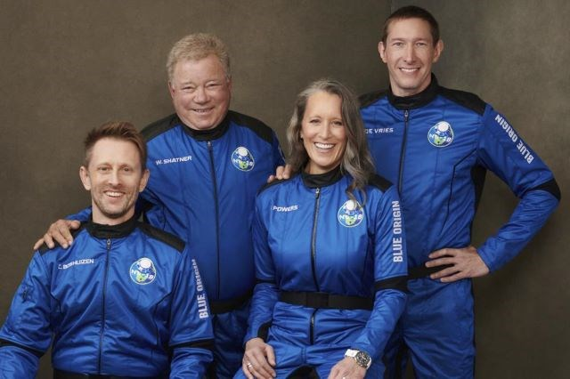 This undated photo made available by Blue Origin shows, from left, Chris Boshuizen, William Shatner, Audrey Powers and Glen de Vries. (Blue Origin via AP)