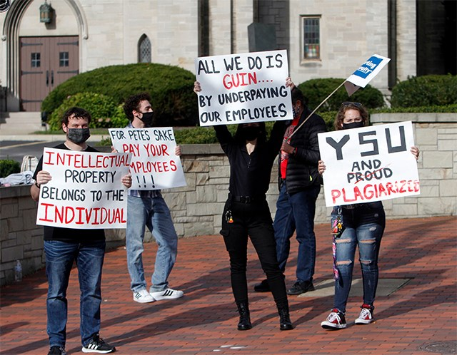 Students hold signs in front of the Butler Institute of American Art on Wick Avenue to show support for faculty members on Day 3 of the YSU-OEA strike Wednesday. (Photo by Robert K. Yosay   Mahoning Matters)