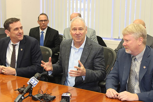 Steve Burns, Lordstown Motors Corp. CEO, center, is flanked by State Sens. Mike Rulli of Salem, R-33rd, and Sean O'Brien of Bazetta, D-32nd, during a press conference Nov. 14, 2019 at Lordstown Motors Corp.'s new headquarters, the former General Motors Lordstown Assembly Complex. (Justin Dennis)