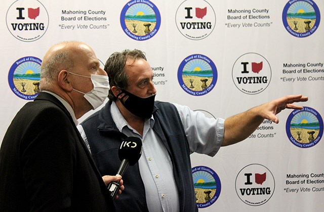 Tom McCabe, Mahoning County Board of Elections deputy director (right), interviews with Israeli journalist Yaron Deckel during his visit to the county elections offices Tuesday, Oct. 27, 2020. (Justin Dennis | Mahoning Matters)