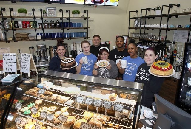 Staff members at Mocha House's new location in downtown Youngstown are, front row from left, Kalli Georgalos, Brilynn Crisp, Christina Vornas, Cierra Mann and Megan Gimmarco; and back row from left, Nick Likaris and Earl Marlowe. (Photo by Robert K. Yosay)