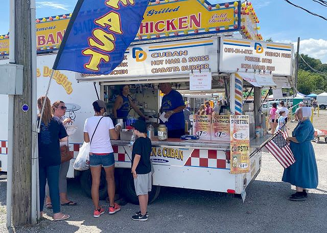 On Friday, many vendors and customers at the Rogers Flea Market were not wearing face coverings a week after Ohio's mask order went into effect. Food vendors may seek exemptions under the law if they work over a hot stove or other potential reasons. (Jess Hardin | Mahoning Matters)