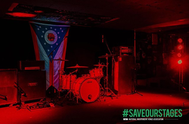 The stage at West Side Bowl shows support for federal legislation to aid performance venues by lighting up red. (Mollie Crowe | Little Blackbird Photos)