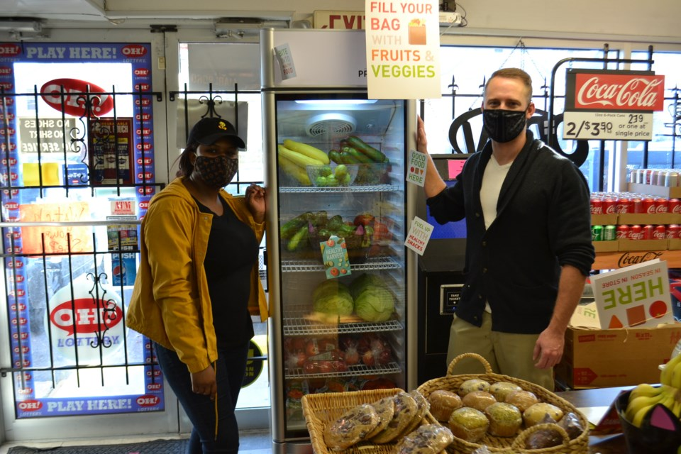 Christian Bennett-Mosley and Kris Kriebel Showcasing Fresh Produce at Cottage Market in Niles in Fall 2020