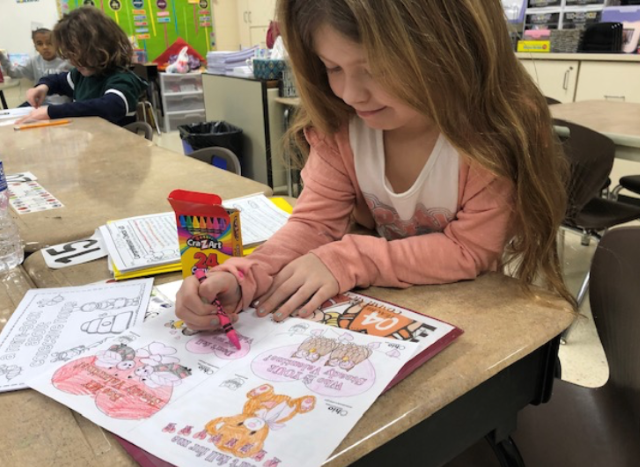 Austintown Elementary School students color valentines to be delivered to seniors at area assisted-living facilities as part of the Don't Fall for Me, Valentine campaign. (Contributed photo)