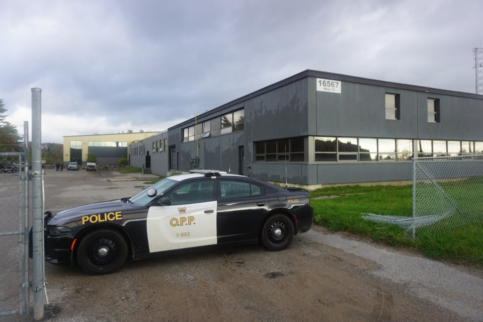 An OPP cruiser is seen outside a vacant Midland factory that was home to a major grow-op. Andrew Philips/MidlandToday