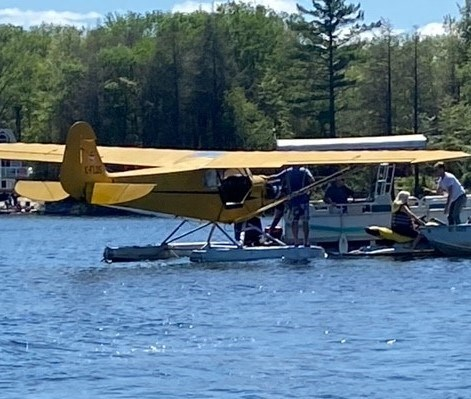 A couple had to jump out of their canoe to avoid being hit by a float plane landing on Trans Canada Bay Sunday afternoon.