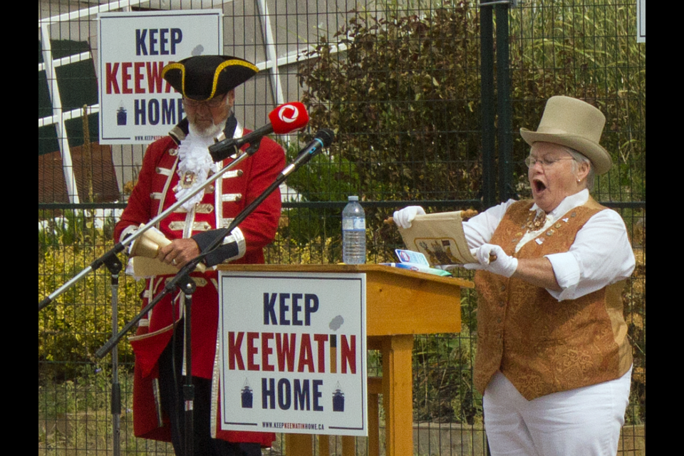 Keep Keewatin Home Cry is delivered by Judy Contin (Midland's Town Crier) and Steve Travers (Barrie's Town Crier).