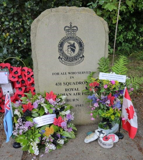 Flowers can been seen at the 431 Squadron memorial in the village of Burn in the United Kingdom