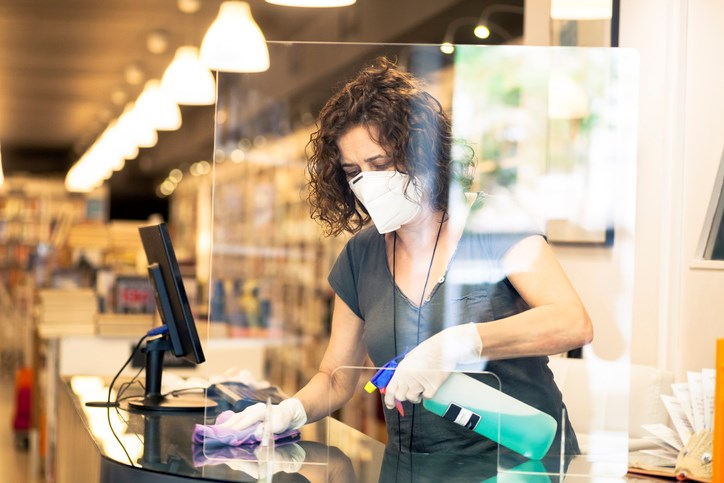 store owner sanitizing