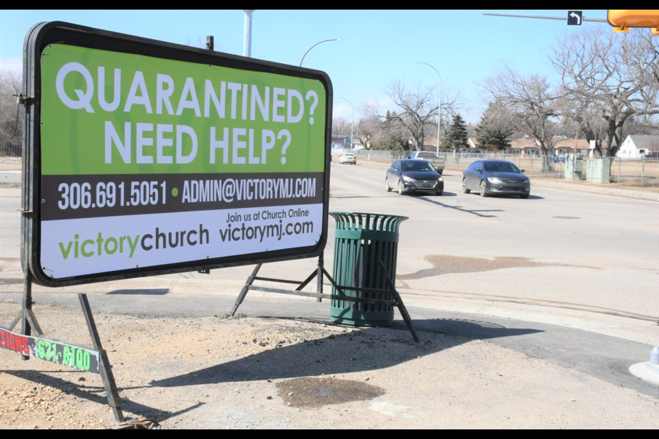 A sign at the corner of First Avenue Northwest and Caribou Street indicates the type of support Victory Church is offering residents. Photo by Jason G. Antonio