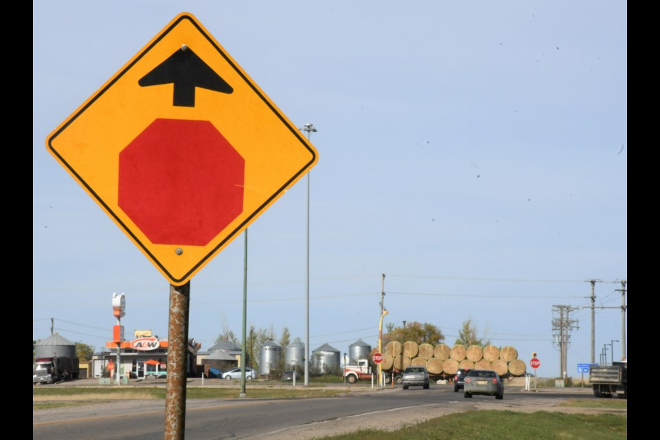 A warning sign reminds motorists to stop before they reach the intersection of Highway 1 and Ninth Avenue Northwest. Photo by Jason G. Antonio