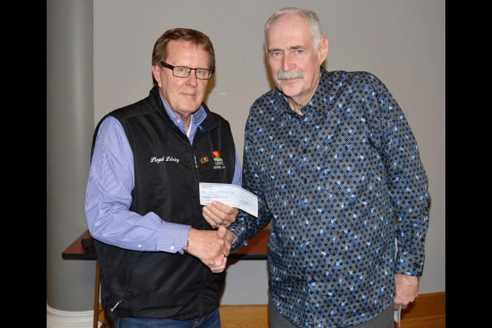 Lloyd Luhning, vice president of the Early Bird Lions Club, left, presents Lyle Johnson, chairman of Moose Jaw Crime Stoppers with a cheque for $500. (Matthew Gourlie photograph)
