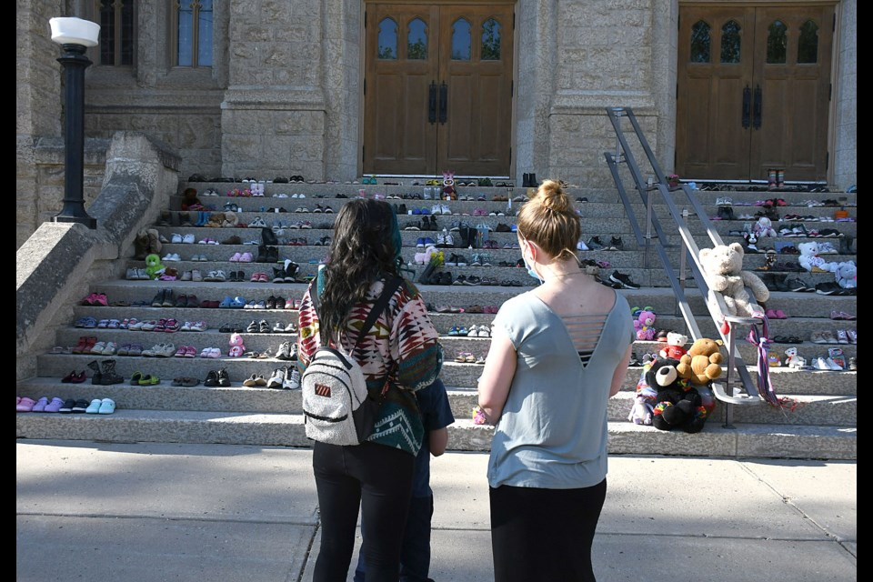People of all ages gathered at the memorial for the 215 victims of the Kamloops residential school located at St. Andrew's United Church.