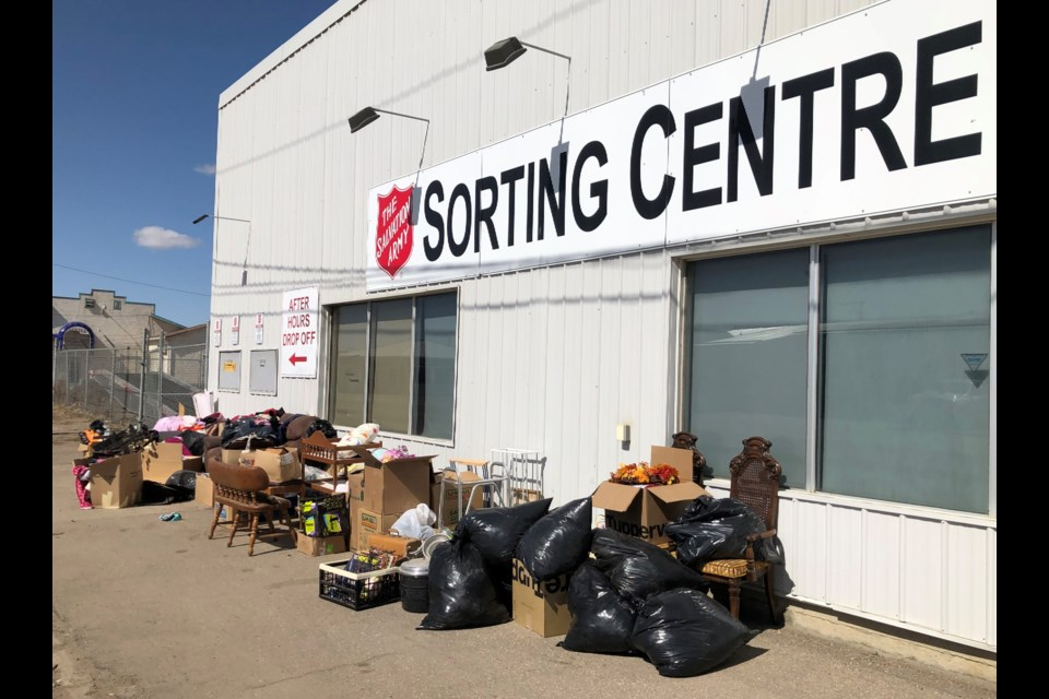A pile of donations built up outside the Salvation Army sorting centre over the Easter long weekend. Most items had to be thrown out because they were considered junk. Photo by Jason G. Antonio