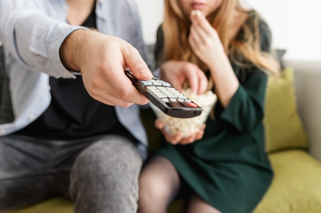 man-holding-remote-control-1040160