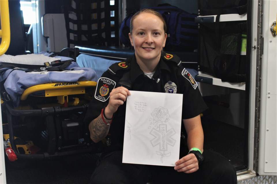 Moose Jaw & District EMS paramedic Aimée Astick, with the piece of artwork she submitted to a recent issue of Canadian Paramedicine.