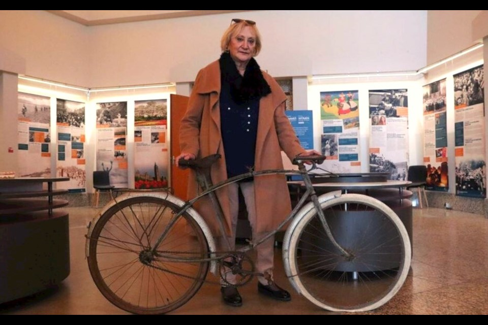 Marie-Claude Halot with the bicycle that was given to her father by a Canadian soldier who landed at Juno Beach in Normandy on D-Day. Photo courtesy Juno Beach Centre