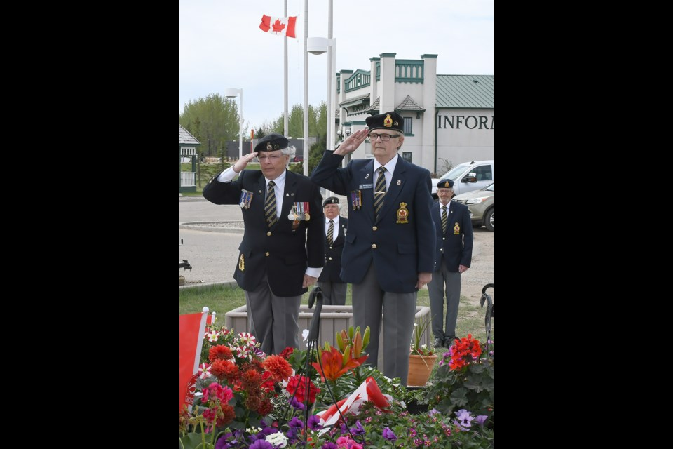 Royal Canadian Legion Branch 59 Moose Jaw vice president Sue Knox and president Sharon Erickson salute after laying a wreath at memorial set up at the base of the Tourism Moose Jaw Snowbirds jet.