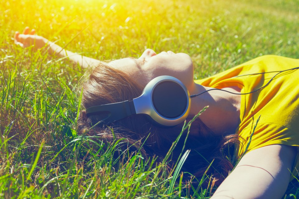 listening to music in the grass shutterstock