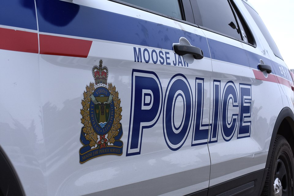 Moose Jaw police car face right