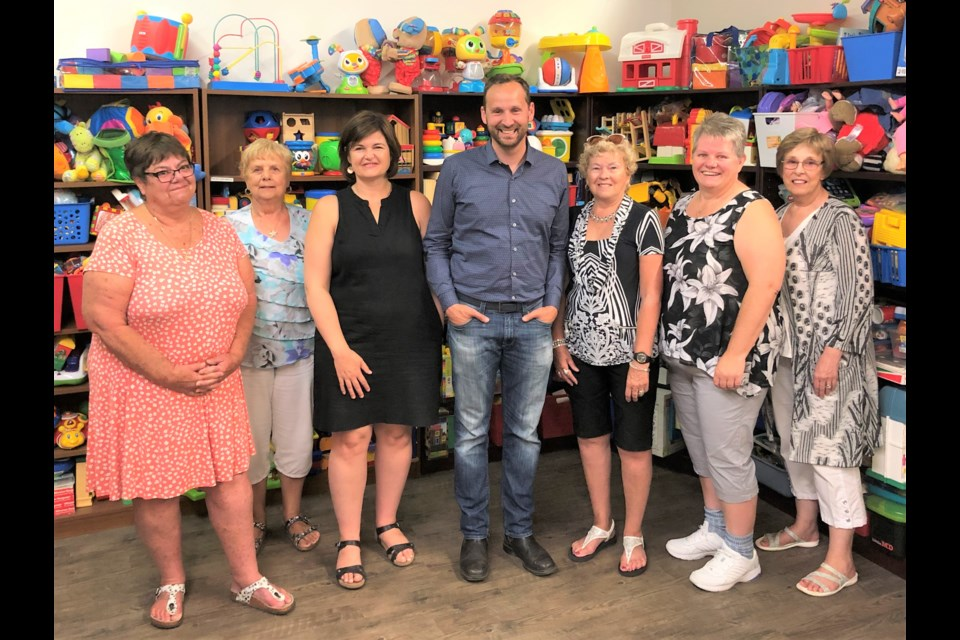 Sask. NDP leader Ryan Meili (middle) meets with staff and volunteers at the South East Early Childhood Intervention Program in Moose Jaw during a tour of the building. Photo courtesy Ryan Meili