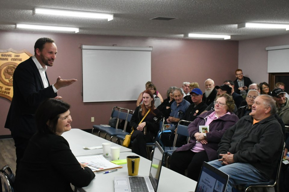Ryan Meili, leader of the Saskatchewan NDP (left, standing), and fellow MLA Carla Beck speak to residents about the importance of Saskatchewan's education system during a town hall in Moose Jaw on Oct. 17. Photo by Jason G. Antonio