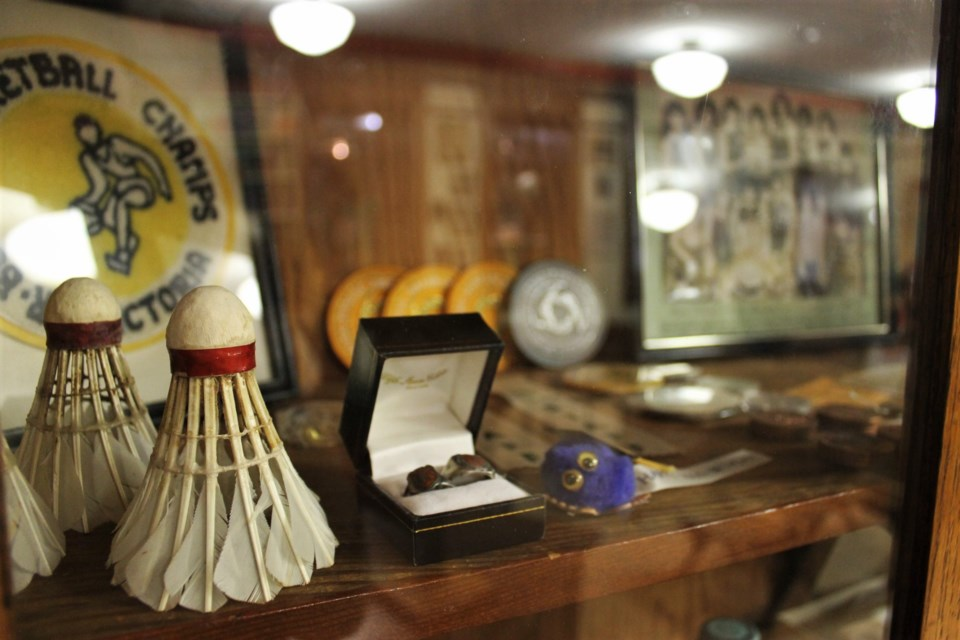 The display cases are home to memorabilia from various sports teams over the years.