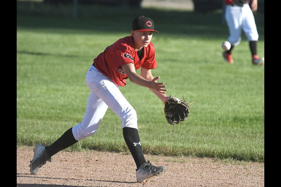 Canucks shortstop Max Simmons tosses to second to start at attempted double play.