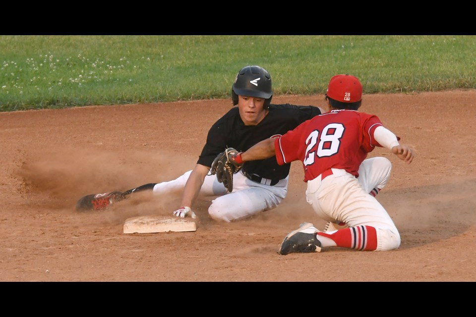 Kaedyn Banilevic successfully slides around the tag to steal second.