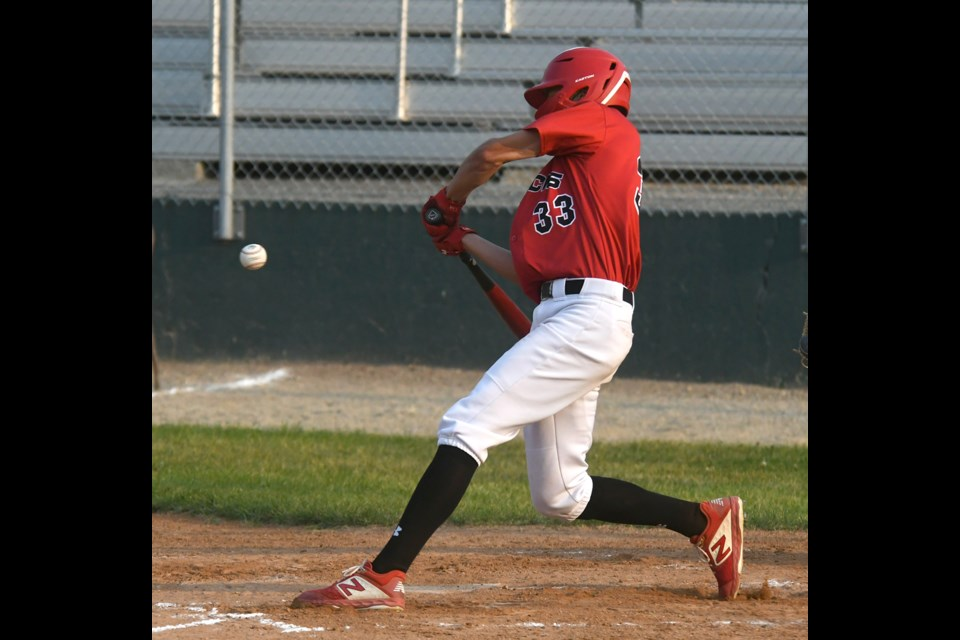 Cole Breitkreuz hits a two-run single in the fourth inning for the Canucks.